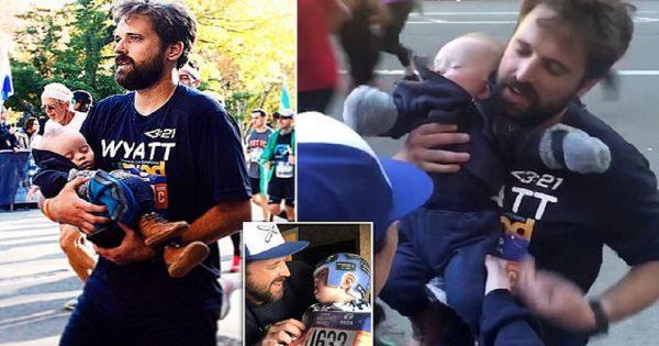Πατέρας τερματίζει στο μαραθώνιο αγκαλιά με τον 7 μηνών γιο του που έχει σύνδρομο Down και συγκινεί 19